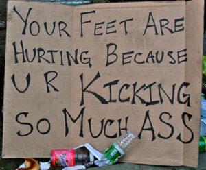 feet hurt marathon sign